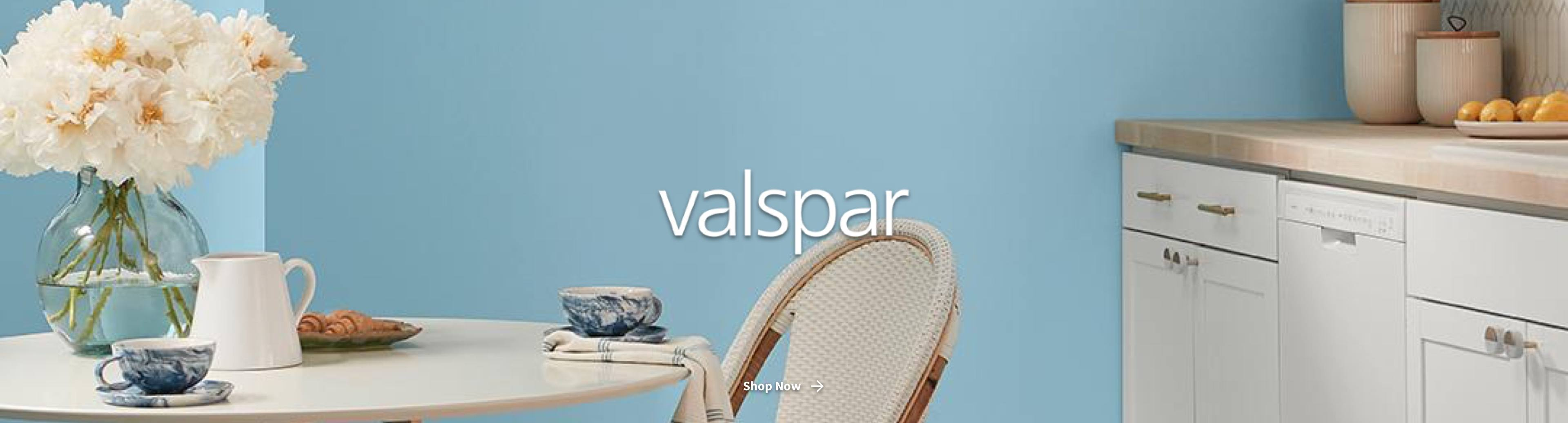 Valspar logo with blue-painted kitchen